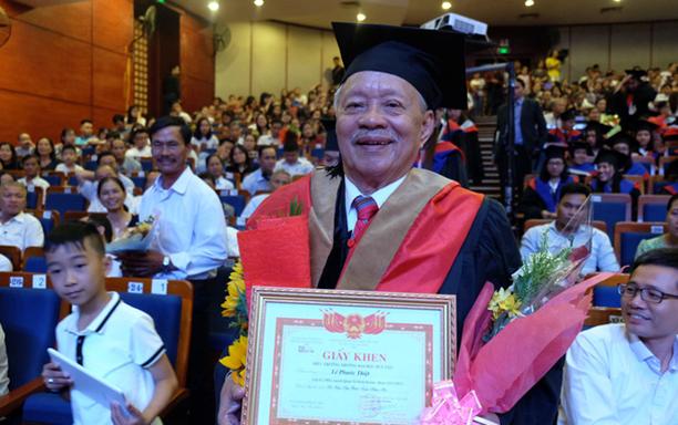 A Joyful 85-Year-old Receiving his MBA